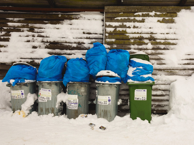 dustbins covered with snow